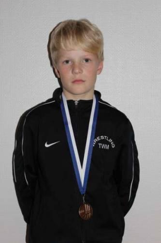 Akseli Orava voitti mestaruuden komeasti selätyksellä.